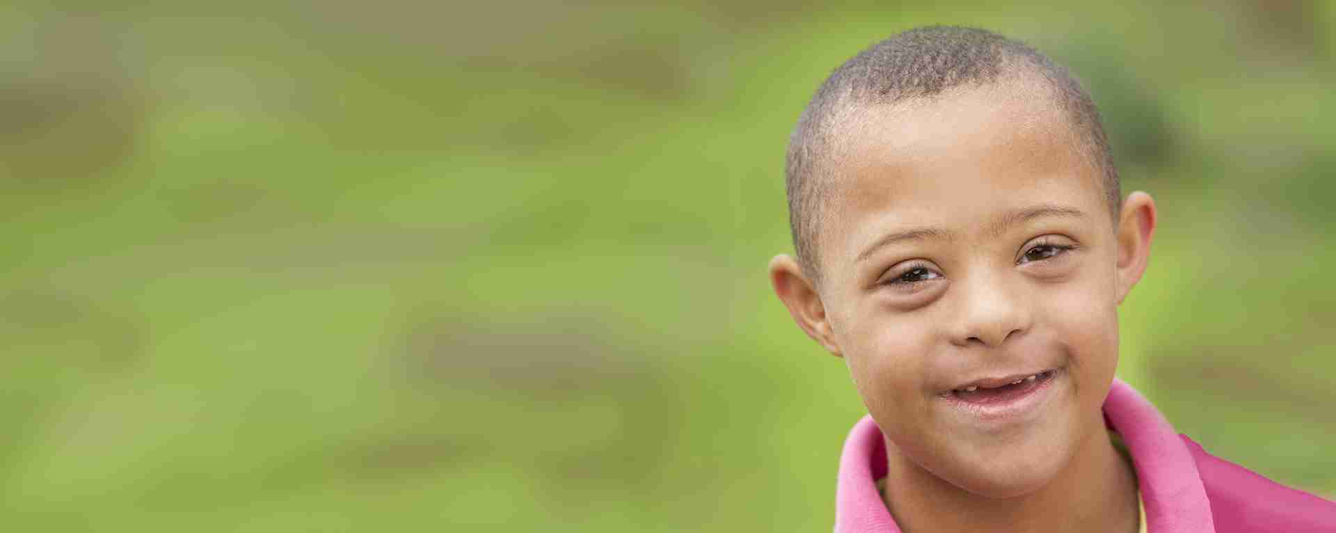 Smiling little boy with Down Syndrome